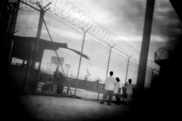 Detainees in camp 4 of Guantanamo Bay in June 2006. (Photo by Paolo Pellegrin/Magnum Photos)