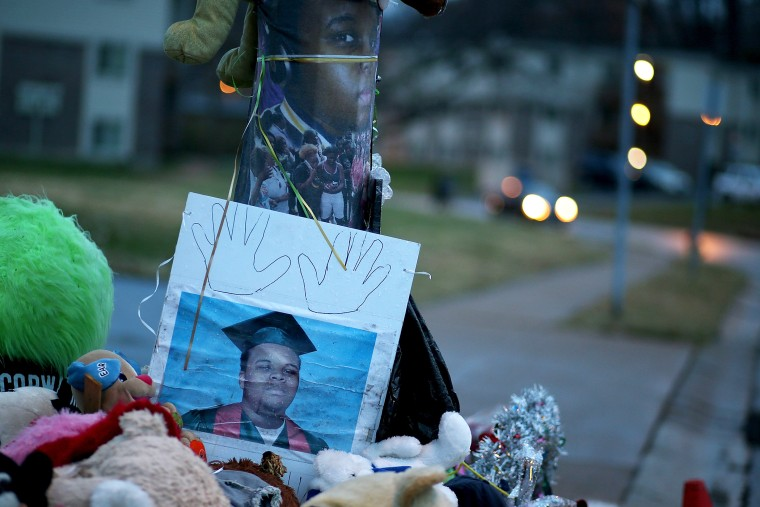 A photo of 18-year-old Michael Brown sits on a memorial on Nov. 22, 2014 in Ferguson, Mo. (Photo by Justin Sullivan/Getty)