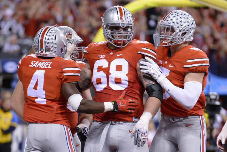 Ohio State Buckeyes running back Curtis Samuel (4) celebrates with Ohio State Buckeyes offensive lineman Taylor Decker (68) and teammates after scoring a touchdown in action during the NCAA Big 10 Championship football game between the Wisconsin Badgers and Ohio State Buckeyes at Lucas Oil Stadium in Indianapolis, Ind. on Dec. 6, 2014.