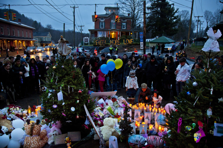 People gather and mourn at makeshift memorial set up around Newtown, Conn. on Dec. 16, 2012 for the victims of the shootings at Sandy Hook Elementary School. (Photo by Mark Peterson/Redux)