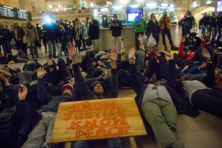 Demonstrators stage a Die-In in Grand Central Terminal protesting the Staten Island, N.Y. grand jury's decision not to indict a police officer involved in the chokehold death of Eric Garner in July on Dec. 6, 2014. (Andrew Burton/Getty)