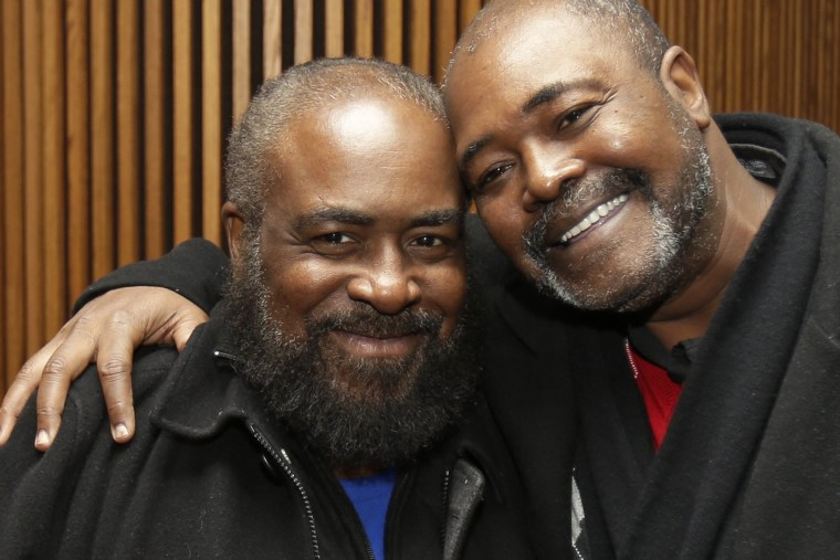 Ronnie Bridgeman, right, now known as Kwame Ajamu, hugs his brother, Wylie Bridgeman, after charges were dismissed on Dec. 9, 2014, in Cleveland, Ohio. (Tony Dejak/AP)