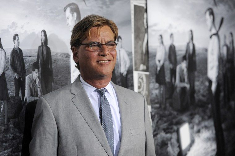 """Aaron Sorkin, creator/executive producer of \""""The Newsroom,\"""" poses at the season 2 premiere of the HBO series at the Paramount Theater on July 10, 2013 in Los Angeles. (Chris Pizzello/Invision/AP)"""