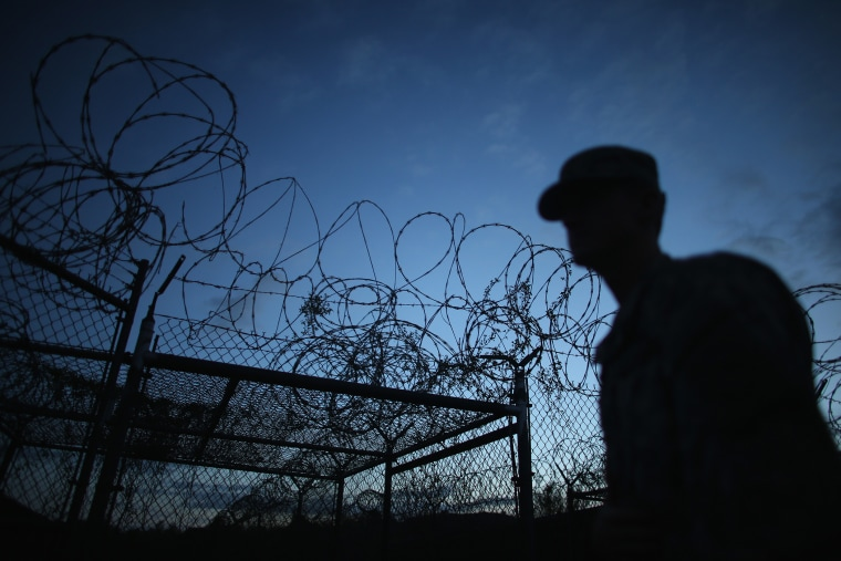 A Public Affairs Officer escorts media through the currently closed Camp X-Ray on June 27, 2013 in Guantanamo Bay, Cuba. (Joe Raedle/Getty)