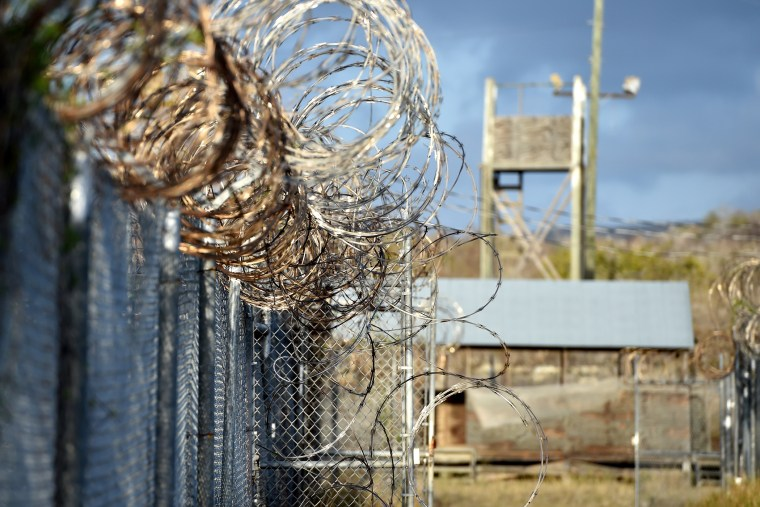 "Razor wire-topped fence at the abandoned ""Camp X-Ray"" detention facility at the US Naval Station in Guantanamo Bay, Cuba, on April 9, 2014. (Mladen Antonov/AFP/Getty)"