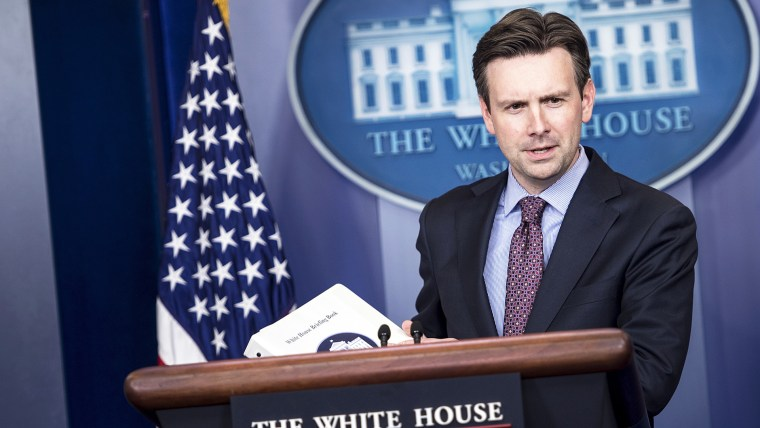 White House Press Secretary Josh Earnest arrives for a daily briefing at the White House on Oct. 15, 2014 in Washington, DC. (Photo by Brendan Smialowski/AFP/Getty)