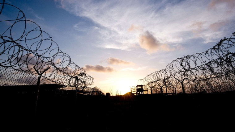 "This April 9, 2014 file photo made during an escorted visit and reviewed by the US military, shows the razor wire-topped fence and a watch tower at the abandoned ""Camp X-Ray"" in Guantanamo Bay, Cuba. (Photo by Mladen Antonov/AFP/Getty)"