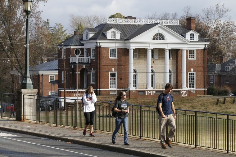 University of Virginia students walk to campus past the Phi Kappa Psi fraternity house at the University of Virginia in Charlottesville, Va. on Nov. 24, 2014. (Steve Helber/AP)