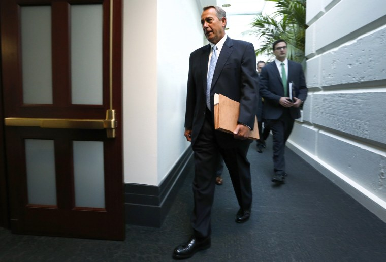 Boehner arrives for a House Republican caucus meeting at the U.S. Capitol in Washington