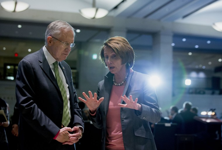 House Minority Leader Nancy Pelosi, a Democrat from California, right, speaks with Senate Majority Leader Harry Reid, a Democrat from Nevada, after an event at the Capitol Visitors Center in Washington, D.C., U.S., on Wednesday, Dec. 10, 2014.