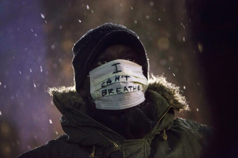 A man stands in falling snow following a news conference where members of Justice League NYC presented a list of demands at City Hall in New York, N.Y. on Dec. 10, 2014. (Photo by Andrew Kelly/Reuters)