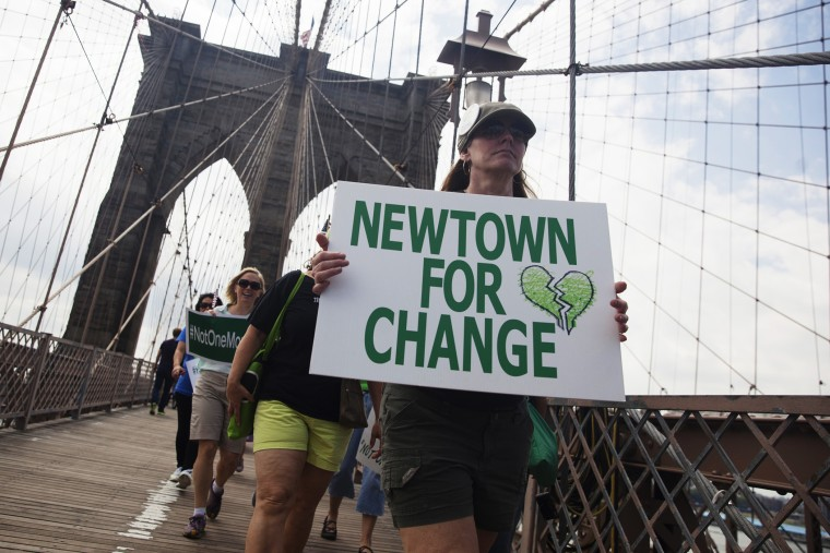 Demonstrators from various groups march across the Brooklyn Bridge in a protest calling for tougher gun control laws, in New York on June 14, 2014. (John Taggart/Reuters)