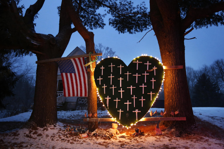 A makeshift memorial with crosses for the victims of the Sandy Hook Elementary School shooting massacre stands outside a home in Newtown, Conn. on Dec. 14, 2013. (Robert F. Bukaty/AP)