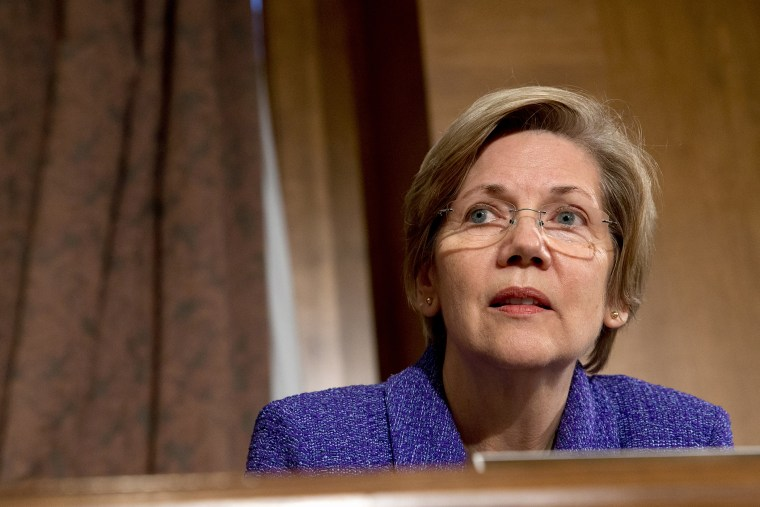 Senate Banking Committee member Sen. Elizabeth Warren listens to testimony on Capitol Hill in Washington on Nov. 12, 2013. (Jacquelyn Martin/AP)