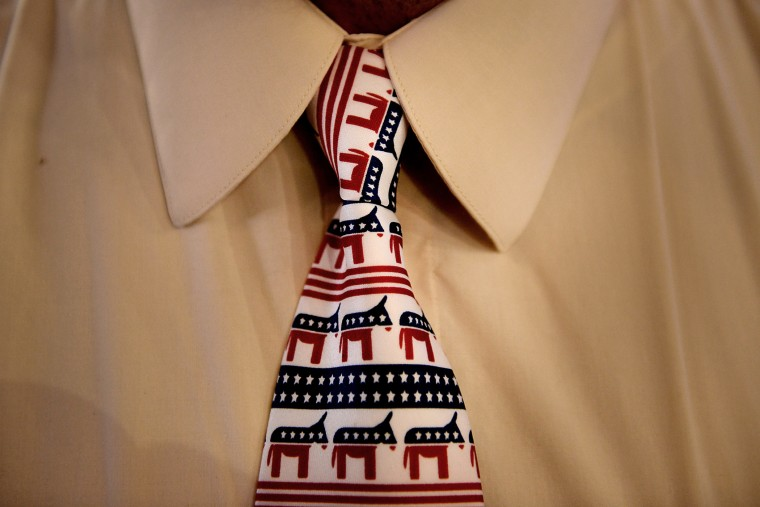 A delegate wears a tie branded with a donkey, the symbol of the Democratic party, during day two of the Democratic National Convention (DNC) in Charlotte, N.C., on, Sept. 5, 2012. (Photo by Daniel Acker/Bloomberg/Getty)