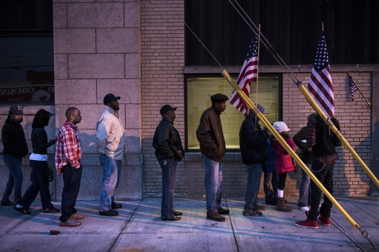 Voters wait in front of the Mt. Pleasant Library November 6, 2012 in Cleveland, Ohio. (Photo by Brendan Smialowski/AFP/Getty)