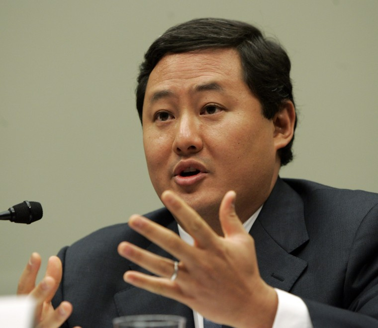 In this June 26, 2008 file photo John Yoo, a law professor at the University of California at Berkeley, testifies on Capitol Hill in Washington.