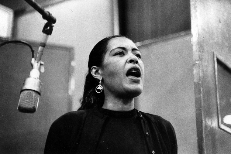 An undated photo of jazz singer Billie Holiday during a recording session.