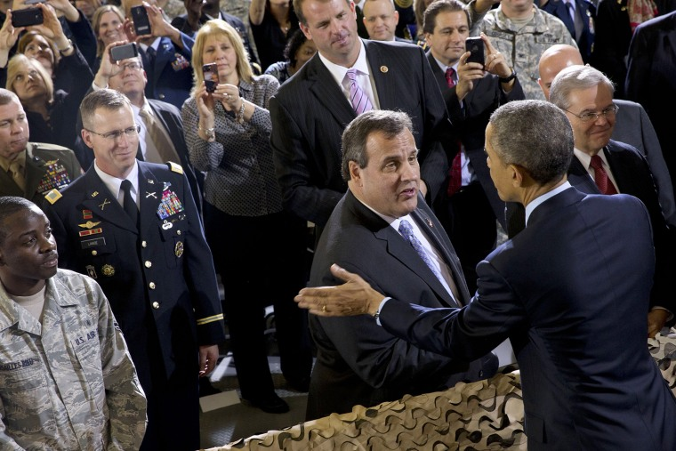 President Barack Obama talks with New Jersey Gov. Chris Christie after speaking to troops at Joint Base McGuire-Dix-Lakehurst, N.J. on Dec. 15, 2014. (Jacquelyn Martin/AP)