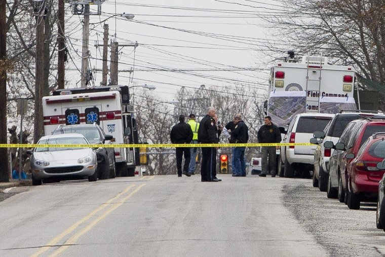 Police have the streets taped off as they search near a home in a suburb of Philadelphia where a suspect in five killings was believed to be barricaded in Souderton, Pa. on Dec. 15, 2014. (Brad Larrison/Reuters)