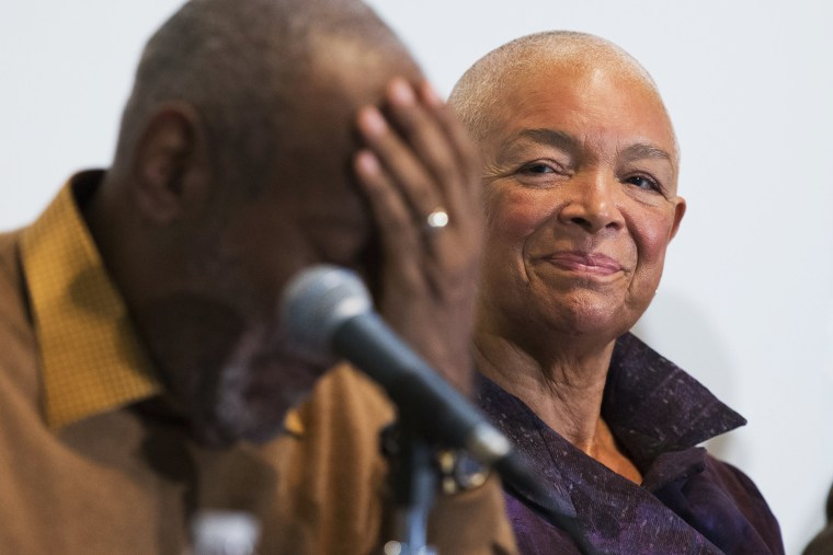 Camille Cosby watches her husband Bill Cosby pause during a news conference on Nov. 6, 2014. (Evan Vucci/AP)
