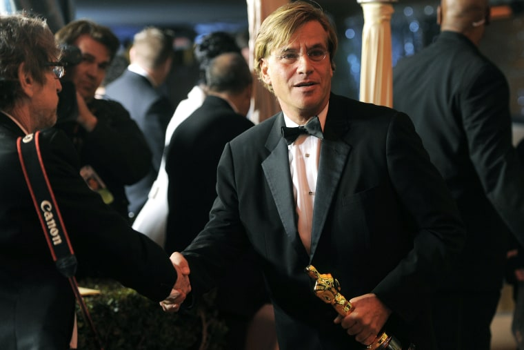 """Writer Aaron Sorkin is seen with his academy award for """"The Social Network"""" following the 83rd Academy Awards on Feb. 27, 2011, in Los Angeles, Calif. (Photo by Chris Pizzello/AP)"""