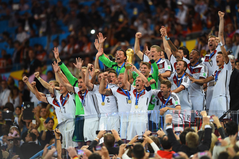 Philipp Lahm of Germany lifts the World Cup trophy after defeating Argentina 1-0 in extra time during the 2014 FIFA World Cup Brazil Final match between Germany and Argentina at Maracana on July 13, 2014 in Rio de Janeiro, Brazil. (Matthias Hangst/Getty)