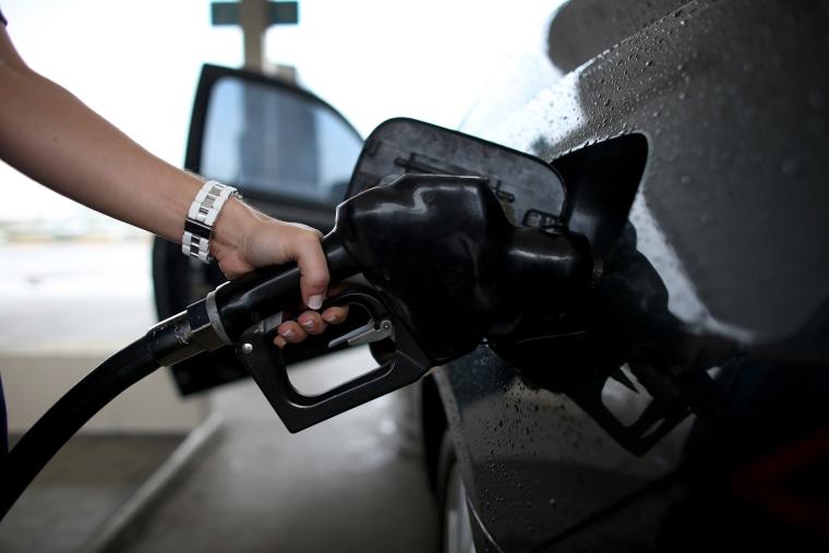 A woman pumps gas into her car on Nov, 15, 2013 in Pembroke Pines, Fla. (Joe Raedle/Getty)