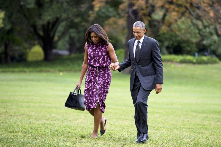 President Barack Obama and first lady Michelle Obama walk on the South Lawn of the White House in Washington, D.C., Sept. 25, 2014. (Photo by Manuel Balce Ceneta/AP)