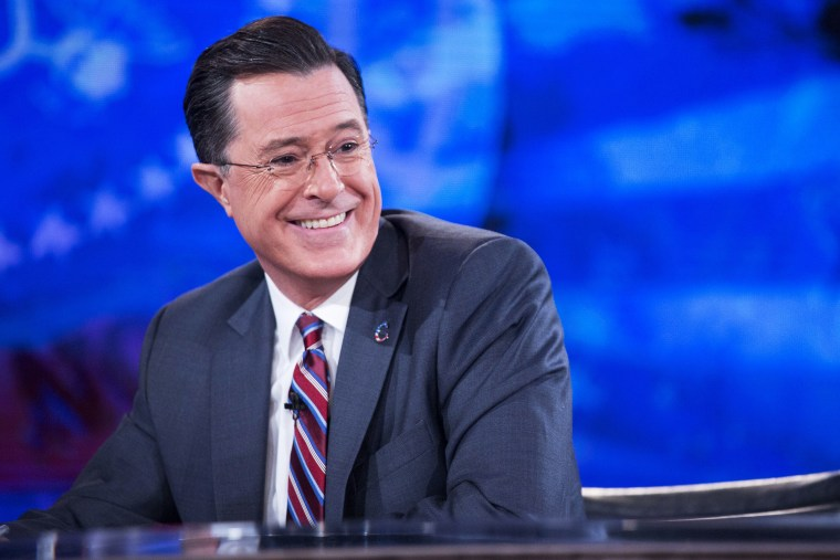 """Television personality Stephen Colbert smiles while taping the \""""The Colbert Report\"""" on Dec. 8, 2014. (Andrew Harrer/picture-alliance/DPA/Pool via CNP/AP)"""