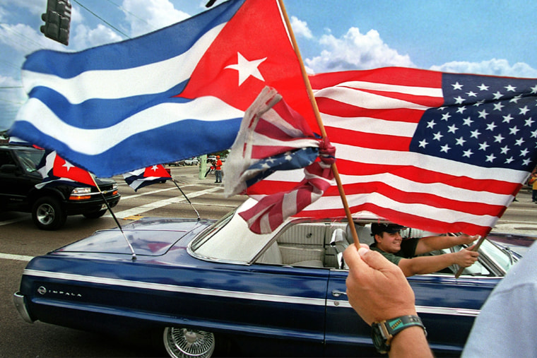 Protestors wave Cuban and American flags in the Little Havana neighborhood of Miami, Fla. on April 25, 2000.