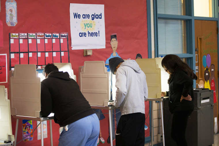 Residents cast their votes at a polling place on Nov. 4, 2014 in Ferguson, Mo. (Photo by Scott Olson/Getty)