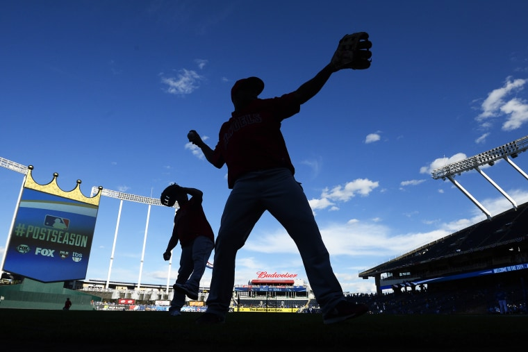 Los Angeles Angels players warm up before a game in Kansas City, Mo. on Oct. 5, 2014. (Photo by Larry W. Smith/EPA)