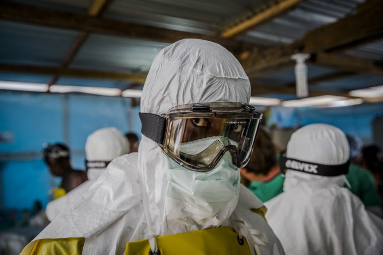 Doctors Without Borders workers suit up in protective clothing before entering an Ebola ward at the Elwa Hospital in Monrovia, Liberia. (Daniel Berehulak/The New York Times/Redux)
