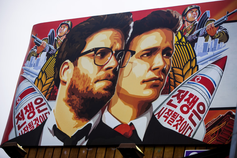 """A banner for \""""The Interview\""""is posted outside Arclight Cinemas, Dec. 17, 2014, in the Hollywood section of Los Angeles. A U.S. official says North..."""