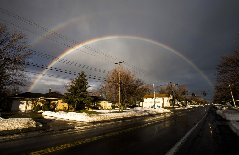 A rainbow forms over a neighbourhood following a massive snow storm in West Seneca