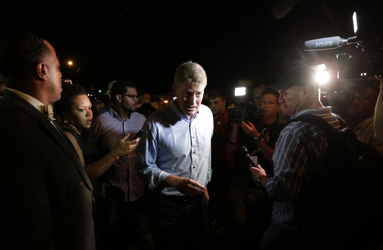 Missouri Attorney General Chris Koster talks to the media at a protest, Aug. 19, 2014, for Michael Brown, who was killed by police Aug. 9 in Ferguson, Mo.