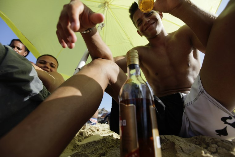 Cubans drink rum at beach on the outskirts of Havana