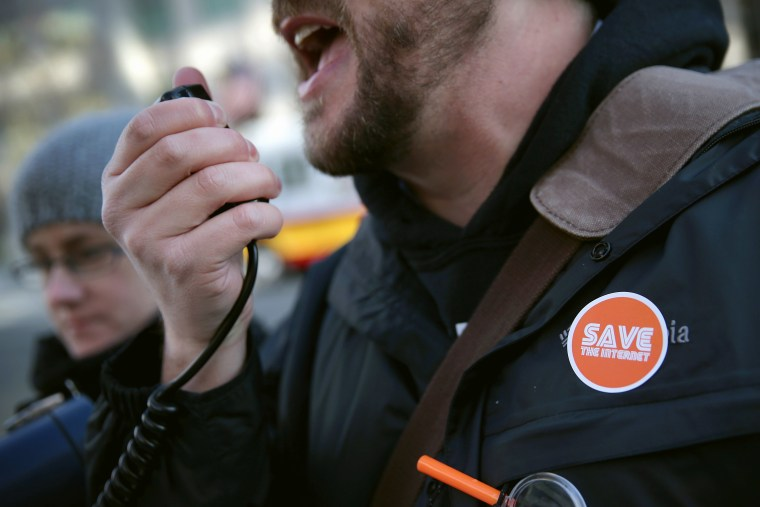 An activist speaks during a rally outside the headquarters of the Federal Communications Commission on Dec. 11, 2014 in Washington, DC. (Alex Wong/Getty)