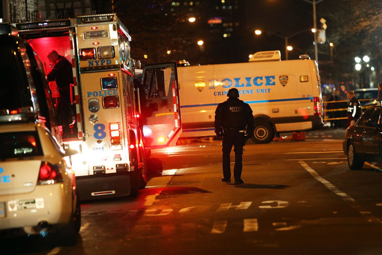 The scene at a shooting where two New York City police officers were killed execution style as they sat in their marked police car on a Brooklyn street corner on Dec. 20, 2014. (Spencer Platt/Getty)