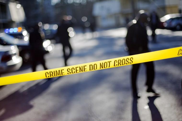 Crime scene tape blocks of an area. (David Goldman/AP)