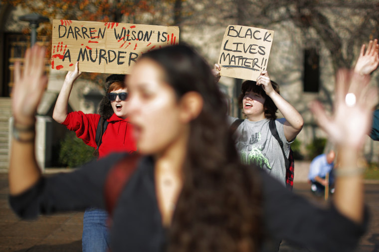 """Demonstrators participate in a nationwide \""""Hands Up, Walk Out\"""" protest at Boston University in Boston, Mass., Dec. 1, 2014. (Brian Snyder/Reuters)"""