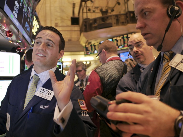 Traders work on the floor at the New York Stock Exchange in New York, Thursday, Dec. 18, 2014.  The market is opening sharply higher, building on gains from...