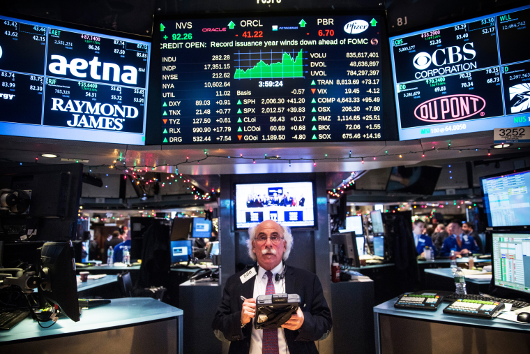 A trader works on the floor of the New York Stock Exchange during the afternoon of Dec. 17, 2014 in New York, N.Y. (Photo by Andrew Burton/Getty)