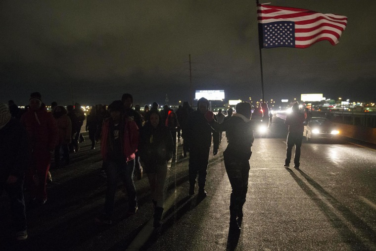 Protesters block Highway 170, after a man was fatally shot by a police man in Berkeley, Mo on Dec. 24, 2014.