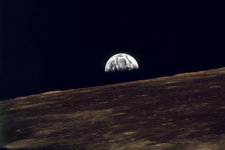 This is how the Earth appears from the moon. The foreground is the moonís surface and in the background is the Earth. This was made from Apollo 8 during a...