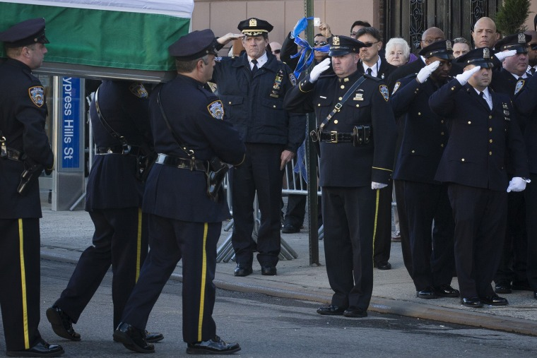 The casket of New York Police Department officer Rafael Ramos arrives to his wake at Christ Tabernacle Church in the Glendale section of Queens, where he was member, on Dec. 26, 2014, in New York.