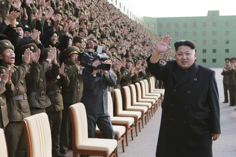 North Korea's leader Kim Jong Un attends a photo session with the participants of a meeting of Korean People's Army (KPA) in this undated photo released by North Korea's Korean Central News Agency (KCNA) in Pyongyang on Nov. 5, 2014. (KCNA KCNA/Reuters)