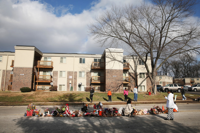 People visit the Michael Brown memorial in the Canfield Green Apartments on Nov. 27, 2014 in Ferguson, Mo. (Photo by Scott Olson/Getty)
