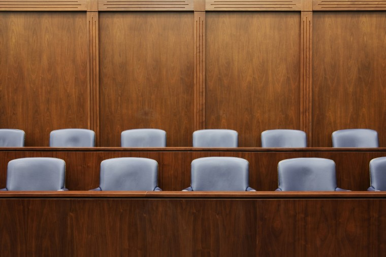Empty jury seats in courtroom. (Jeremy Woodhouse/Gallery Stock)